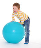 Little boy with a big ball. Royalty Free Stock Image