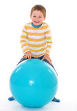 Little boy with a big ball. Royalty Free Stock Images