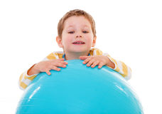 Little boy with a big ball. Stock Image