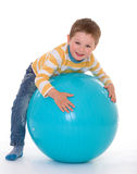 Little boy with a big ball. Royalty Free Stock Photo