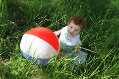 Little boy with big ball outdoors Royalty Free Stock Image