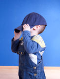 A little boy with big baseball cap Stock Photos