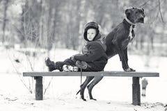 Little boy with  big black dog. Little boy with a big black dog Stock Photos