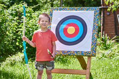 Little boy with big bow near sport aim Stock Photo