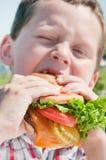 Little boy, big burger Stock Photo