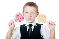 Little boy with big candy on white background. Boy with big candy on white background stock photography
