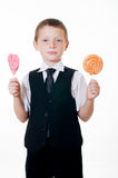 Little boy with big candy on white background Stock Photos