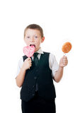 Little boy with big candy on white background Royalty Free Stock Image
