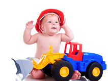 Little boy  with a big car Stock Photos