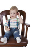 Little boy in the big chair Stock Photography