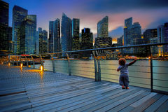 Little boy in a big city Royalty Free Stock Photo
