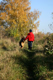 Little boy and big dog (German Shepherd ). Little boy on the walk with the big, obedient dog on suburb of the city Stock Image