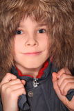 Little boy in big fur hood, looking at camera Royalty Free Stock Images
