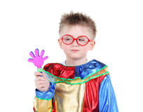 Little boy in big glasses and clown costume holds toy hand Stock Photo