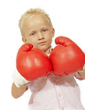 Little boy big gloves. Boy with blond hair standing with red boxing gloves thinking about big moments Stock Photo