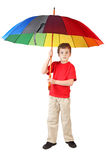 Little boy in with big multicolored umbrella Stock Images