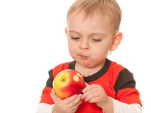 Little boy with a big red apple Stock Photography