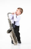 Little boy and the big saxophone. Royalty Free Stock Image