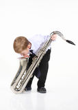 Little boy and the big saxophone. Royalty Free Stock Photos