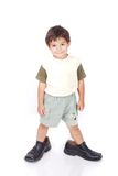 Little boy in big shoes. A little boy is standing in adult shoes Royalty Free Stock Photos