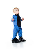 Little boy on the big shoes Stock Photography