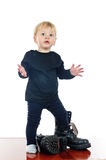 Little boy and big shoes Stock Images