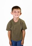 Little boy, big smile. Young boy 3/4 length portrait smiling on white background Royalty Free Stock Photos