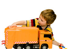 Little boy with a big toy car Stock Photography