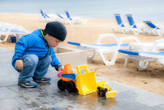 Little boy with a big toy car Stock Images