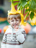 Little boy with big yellow flower Royalty Free Stock Photos