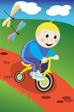 Little boy on the bike Royalty Free Stock Image