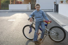Little boy with bike Royalty Free Stock Image
