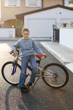Little boy with bike Stock Photos