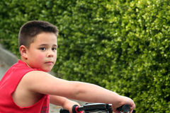 Little Boy and Bike. Young boy riding his first bike stock photo