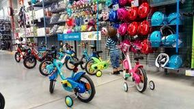 Little  boy in a bike shop Stock Photos