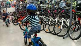 Little  boy in a bike shop Royalty Free Stock Photo
