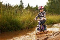 Little boy on bike stock image