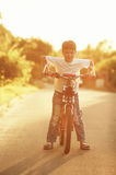 Little boy with bike on sunset Royalty Free Stock Photography