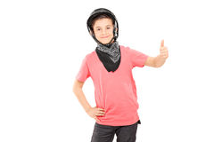 Little boy with bikers helmet giving thumb up Stock Photography