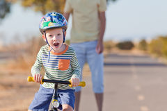 Little boy biking Royalty Free Stock Photos