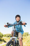 Little boy biking through mountains Royalty Free Stock Images
