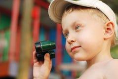 Little boy with binoculars Stock Photo