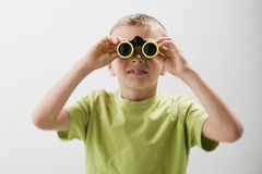 Little boy with binoculars. White background Stock Photo