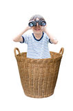 Little boy with binoculars in the Basket Stock Image