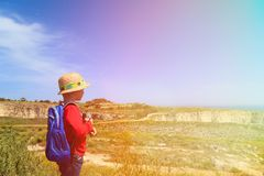 Little boy with binoculars hiking in mountains Stock Image