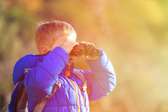 Little boy with binoculars hiking in mountains Royalty Free Stock Images