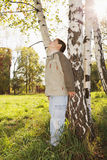 Little boy at birch tree in park Stock Images