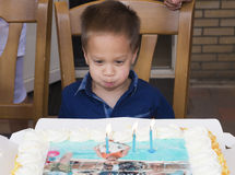 Little boy with birthday cake Stock Image