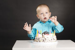 Little boy with birthday cake. On dark background Royalty Free Stock Photo