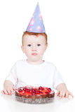 Little boy with birthday cake over white Royalty Free Stock Photography